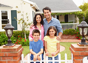 Family in Front of Home - Home Insurance